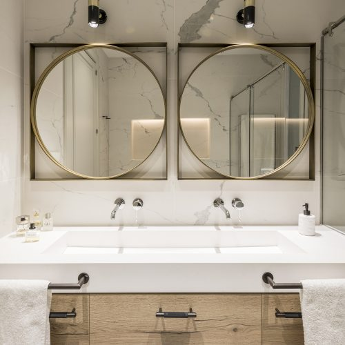 Bathroom with round mirrors